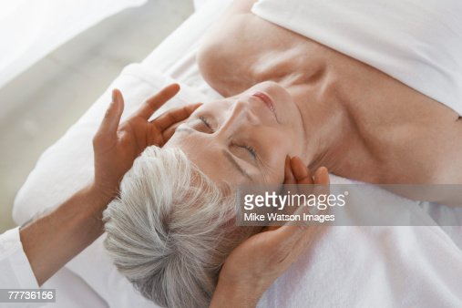 Woman Receiving a Facial Massage : Stock Photo