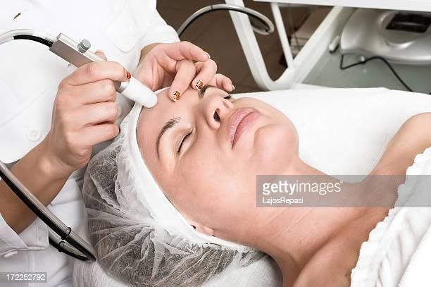 Woman receiving a facial prep for surgery