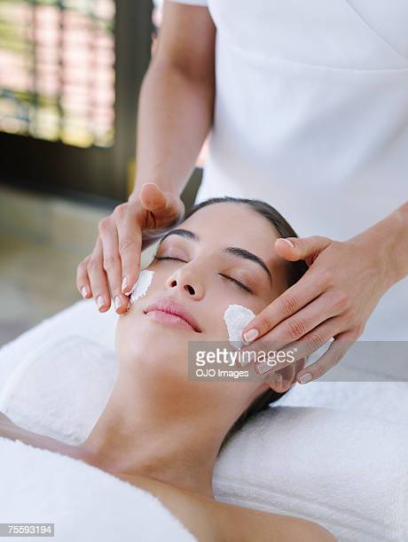 Woman receiving a facial treatment