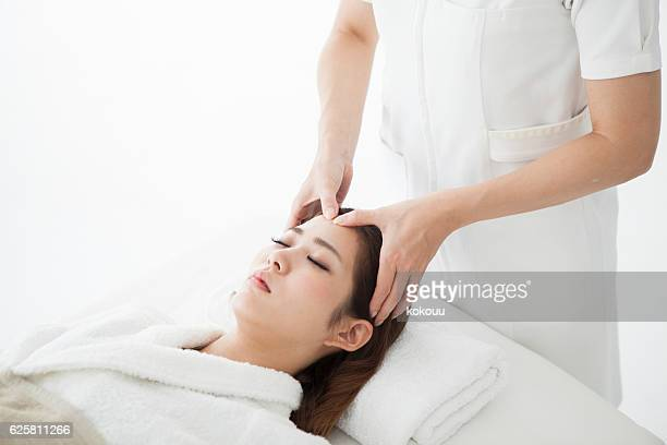 Woman receiving a head spa for beauty