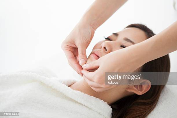 Woman receiving a massage at a salon