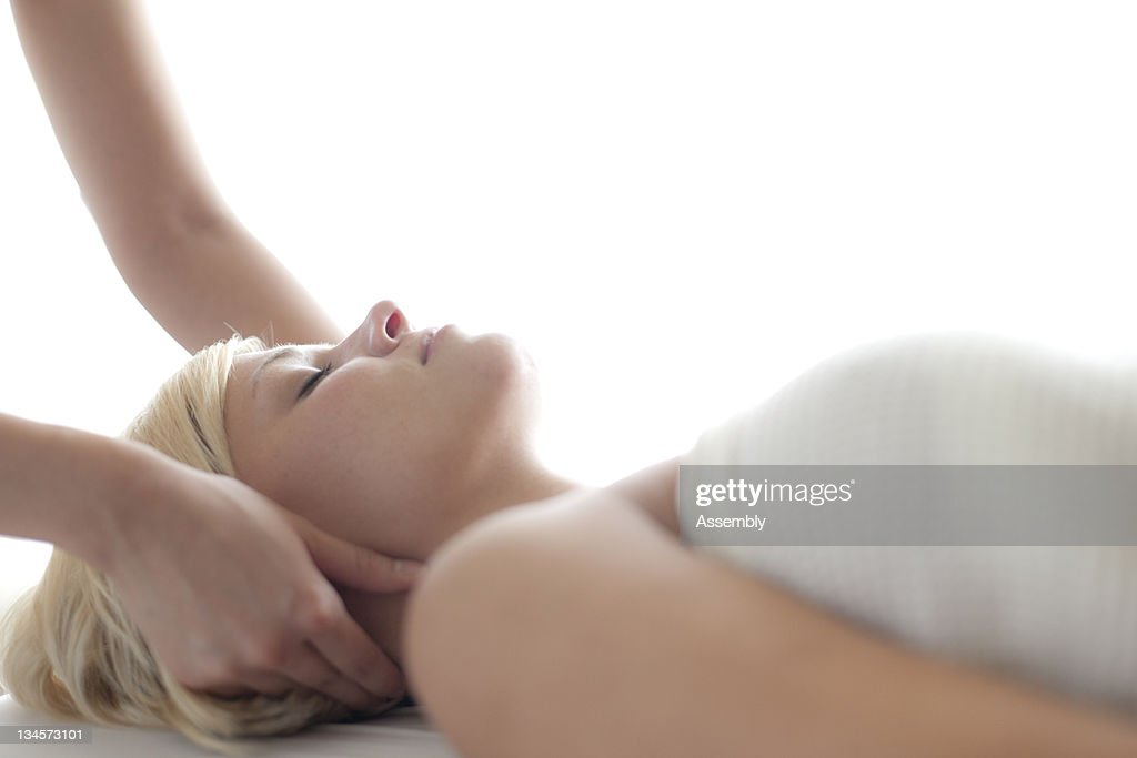 Woman receiving a massage at a spa. : Stock Photo