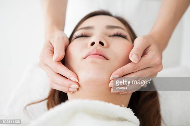 Woman receiving a massage to adjust her skin