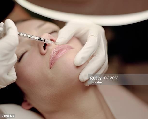 Woman receiving a neurotoxin injection injection