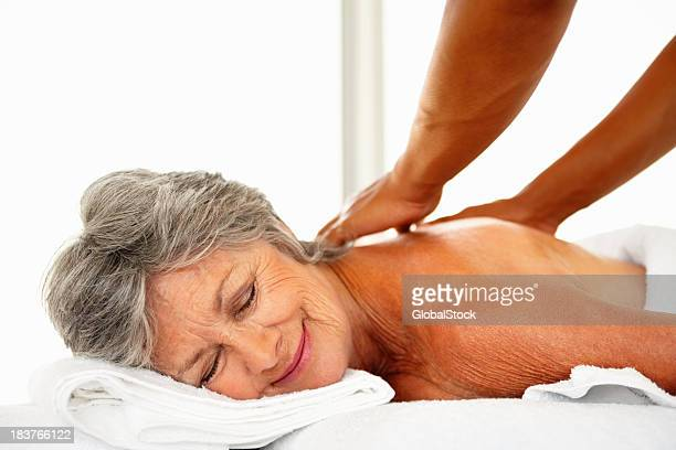 Woman receiving back massage