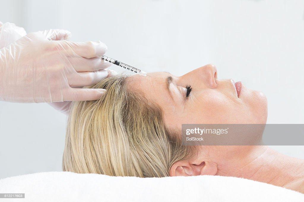 Woman Receiving Botox Injection : Stock Photo