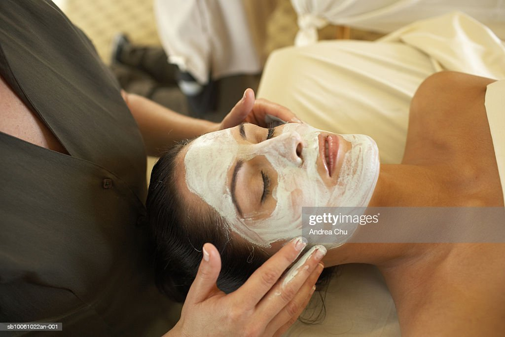 Woman receiving facial treatment in spa