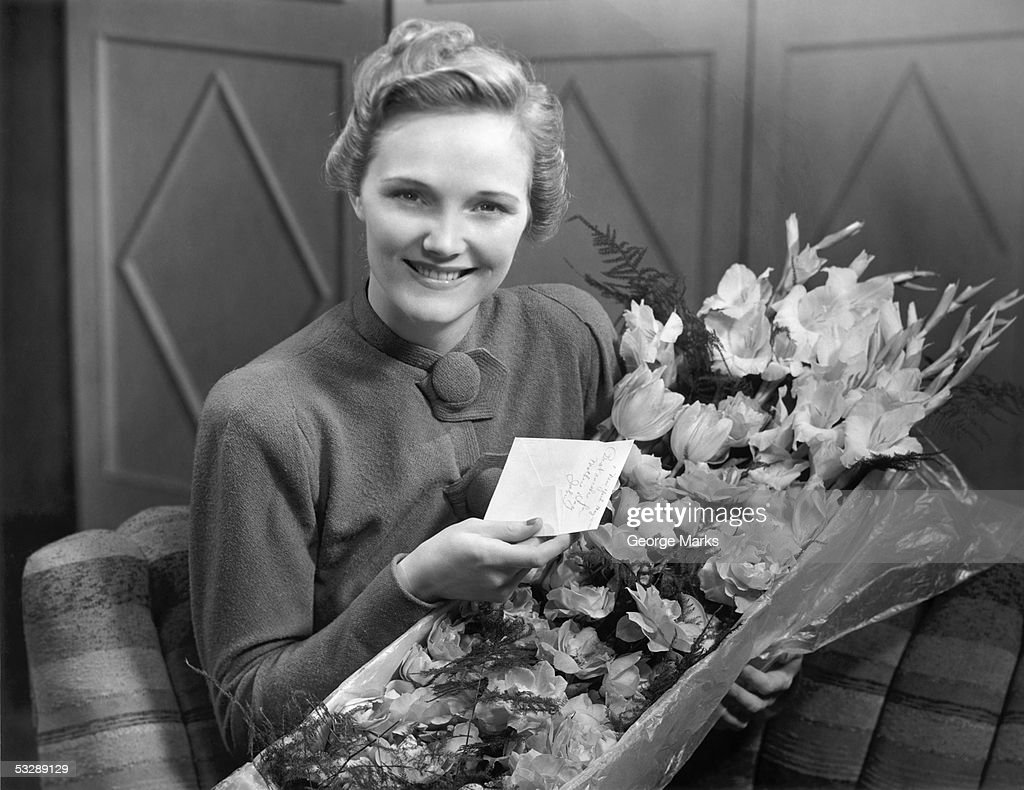 Woman receiving flowers : Stock Photo