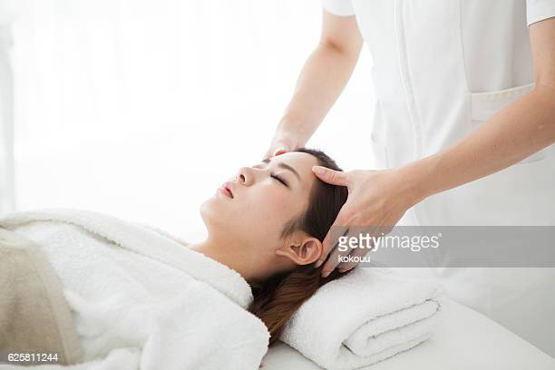 Woman receiving head spa