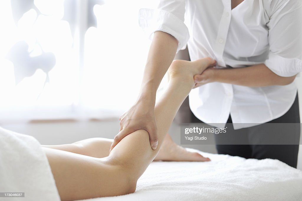 woman receiving oil massage and relaxing : Stock Photo