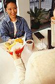 Woman receiving order in fast food restaurant