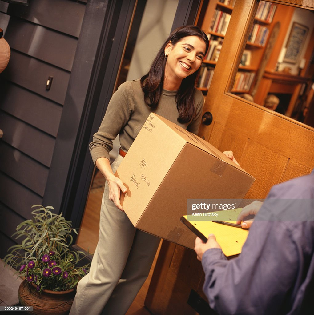 Woman receiving package : Stock Photo