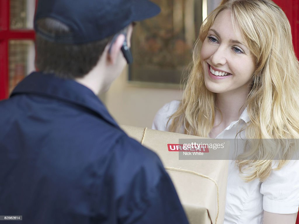 Woman receiving urgent delivery : Stock Photo