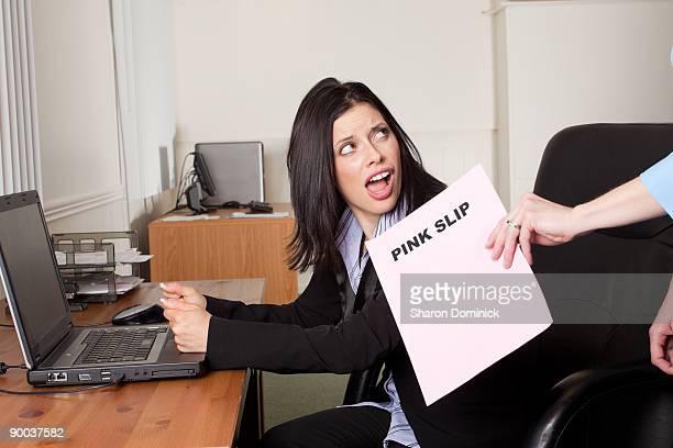 Woman Recieving a Pink Slip