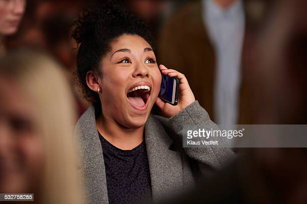 Woman recieving good news on the phone