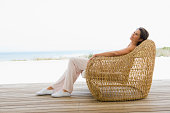 Woman reclining on a chair on the beach