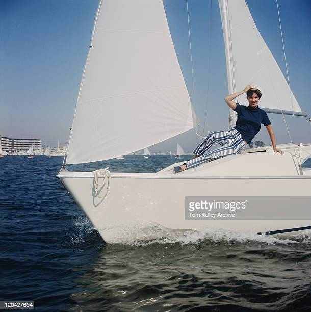 Woman reclining on sailing boat, portrait