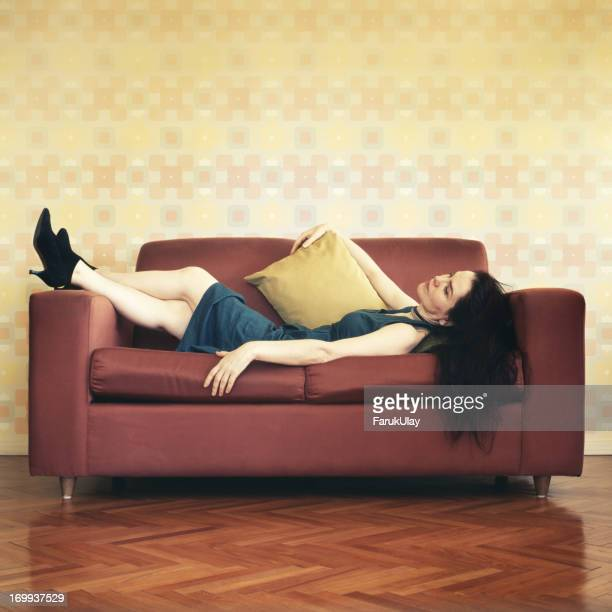 Woman Reclining on Sofa
