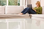 Woman reclining with laptop computer