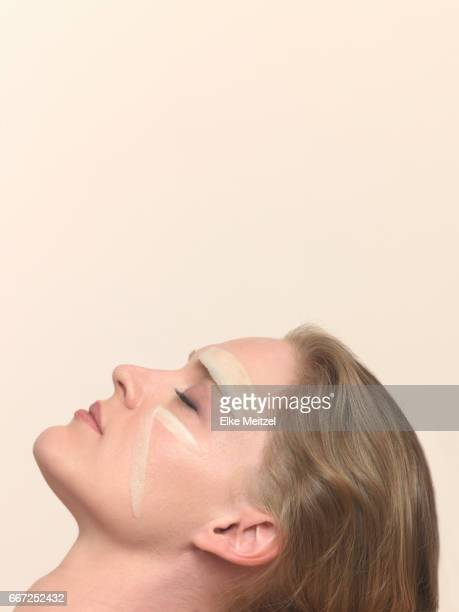 woman reclining with vegetables on her face