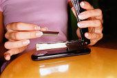 Woman refilling stapler