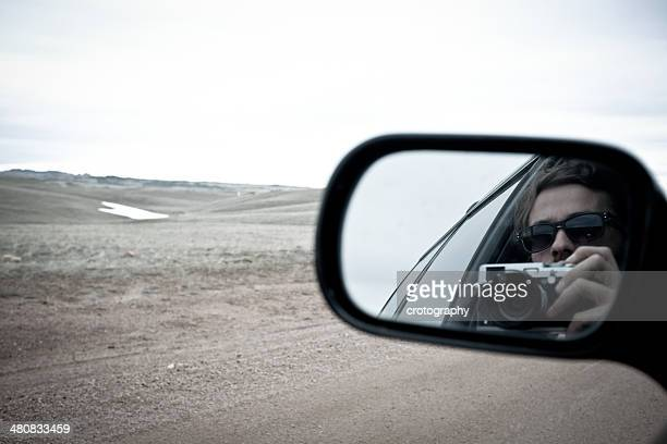 Woman reflecting in side mirror
