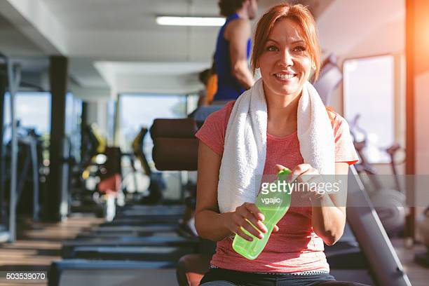 Woman refreshing after training