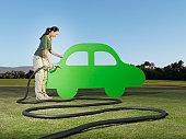 Woman refueling cutout car