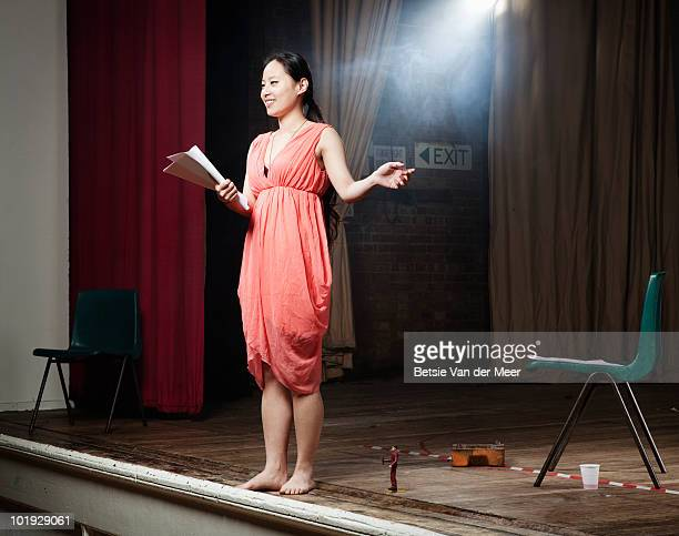woman rehearing play on stage.
