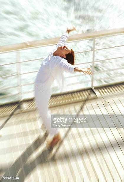 Woman Rejoicing on Cruise Ship Deck