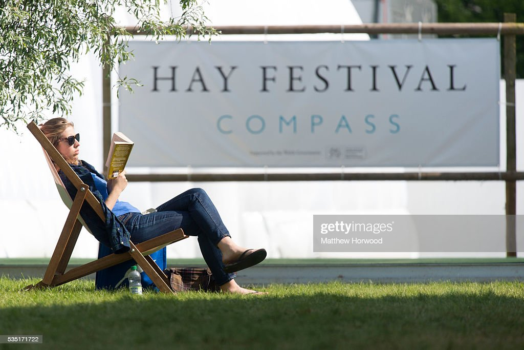A woman relaxes during the 2016 Hay Festival on May 29, 2016 in Hay-on-Wye, Wales. The Hay Festival is an annual festival of literature and arts now in its 29th year.