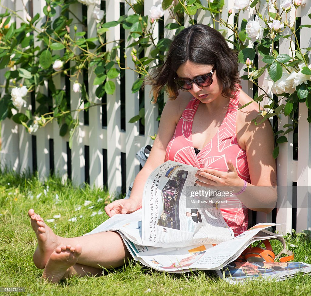 A woman relaxes in the warm summer weather during the 2016 Hay Festival on May 29, 2016 in Hay-on-Wye, Wales. The Hay Festival is an annual festival of literature and arts now in its 29th year.