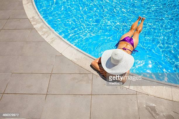 woman relaxing at a resort swimming pool