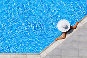 woman relaxing in resort swimming pool