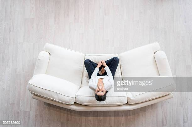 Woman relaxing at home on the sofa