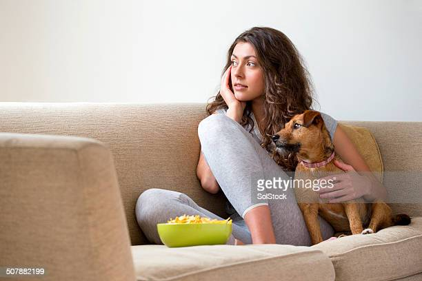 Woman Relaxing at Home with Pet Dog