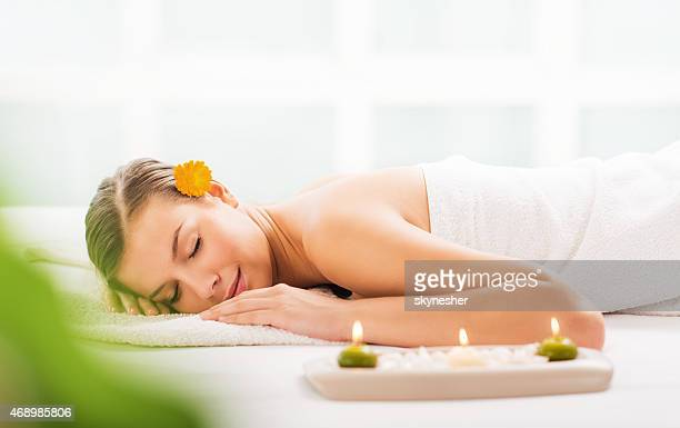 Woman relaxing at spa.