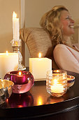 Woman Relaxing by Candles