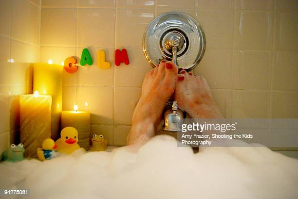 Woman relaxing in a bubble bath