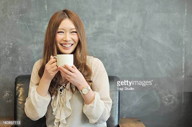 Woman relaxing in a cafe