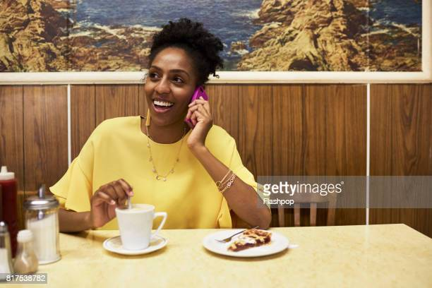 Woman relaxing in a cafe using phone
