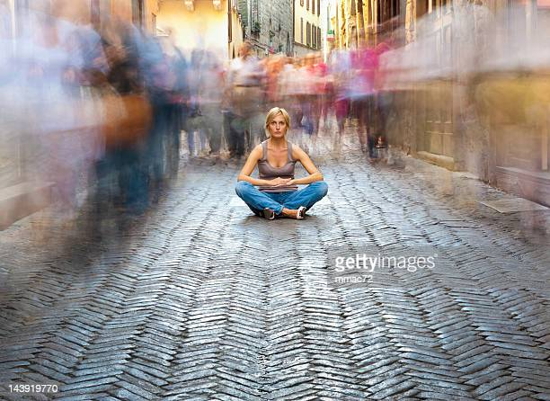 Woman Relaxing in a Crowded Street