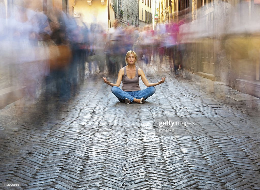 Woman Relaxing in a Crowded Street : Stock Photo