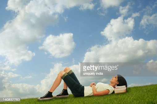 Woman relaxing in a field, Gurgaon, Haryana, India