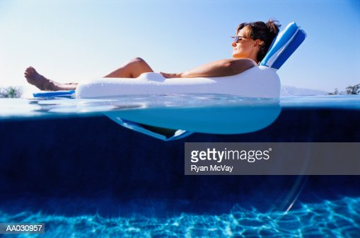 woman relaxing in a floating chair stock photo | getty images