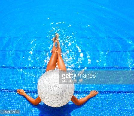woman relaxing in a resort swimming pool