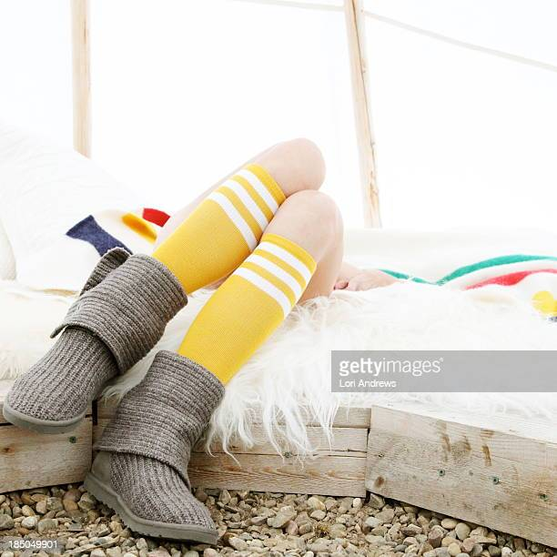 Woman relaxing in a White teepee