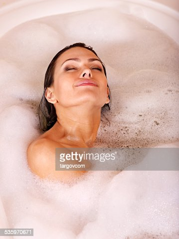 Woman relaxing in bath : Stock Photo