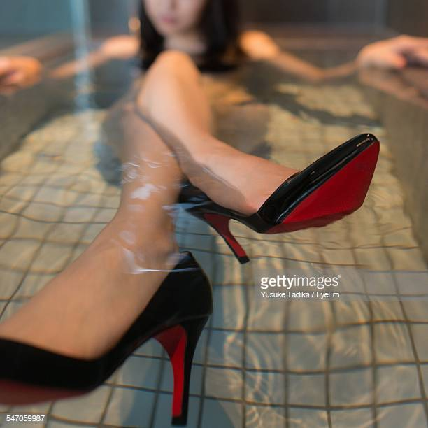 Woman Relaxing In Bathtub With High Heels