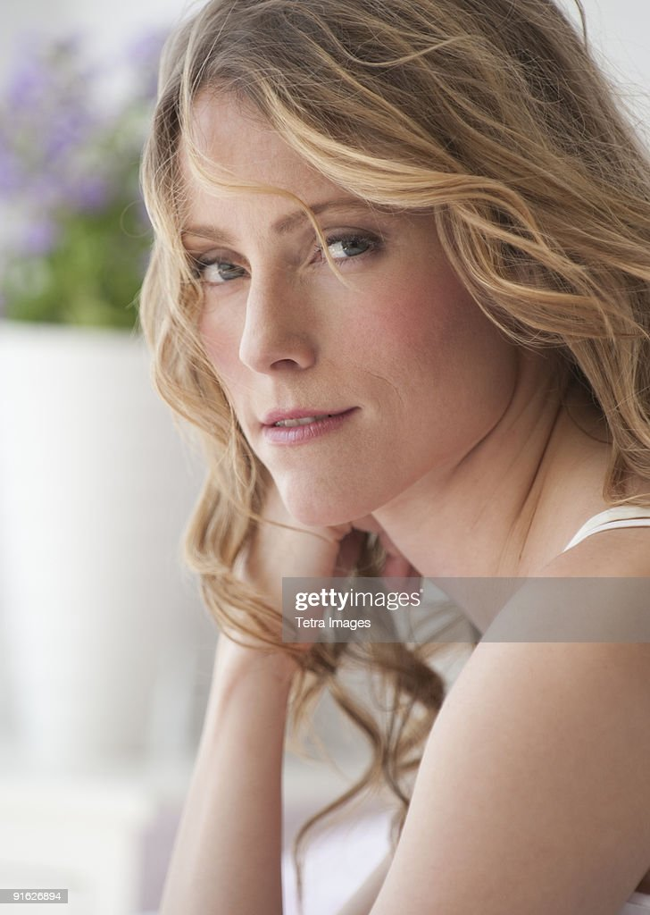 A woman relaxing in bed : Stock Photo
